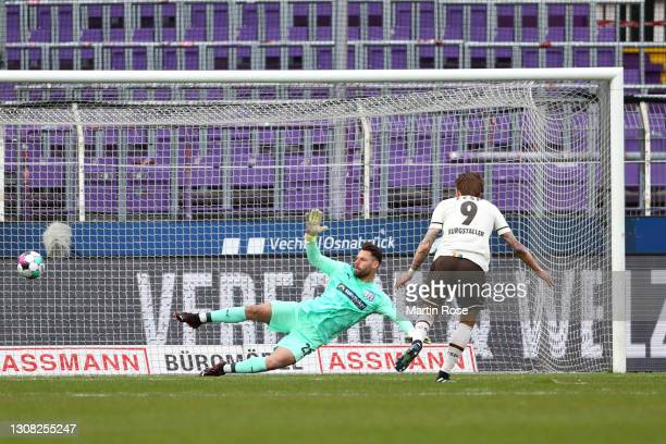 Guido Burgstaller of FC St. Pauli scores their side's first goal past Philip Kuhn of Vfl Onasbrueck from the penalty spot during the Second...