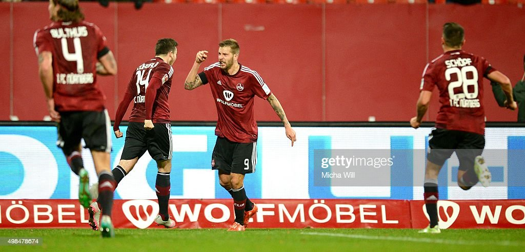 Guido Burgstaller (3rd L) of Nuernberg celebrates after scoring his team's second goal during the Second Bundesliga match between 1. FC Nuernberg and Eintracht Braunschweig at Grundig-Stadion on November 23, 2015 in Nuremberg, Germany.