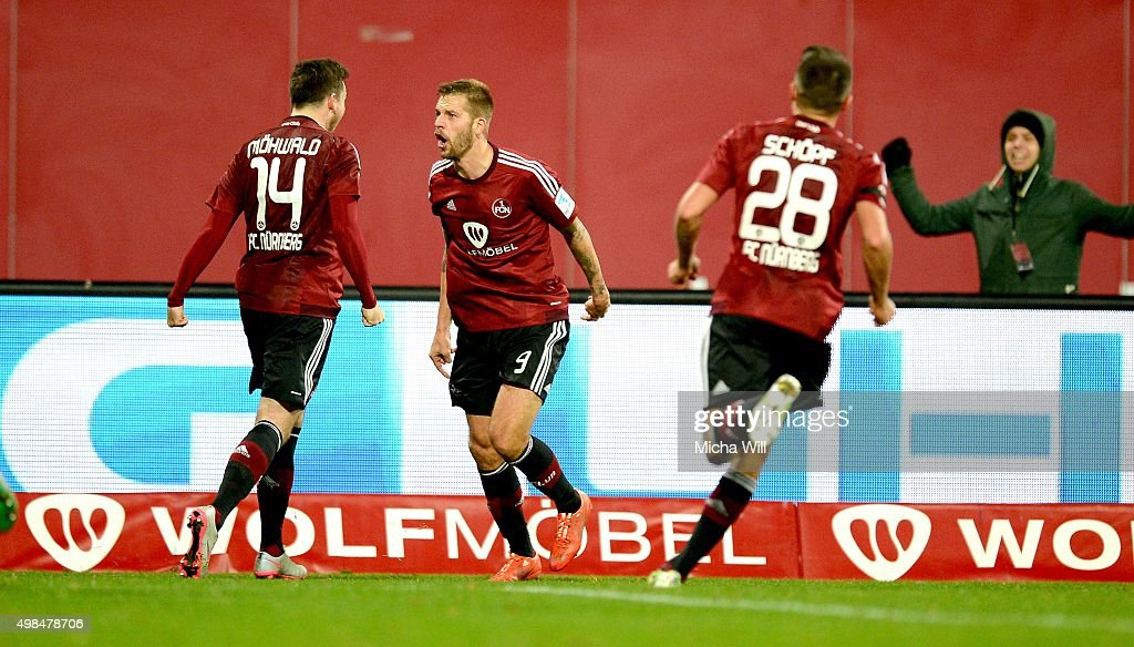 Guido Burgstaller (C) of Nuernberg celebrates after scoring his team's second goal during the Second Bundesliga match between 1. FC Nuernberg and Eintracht Braunschweig at Grundig-Stadion on November 23, 2015 in Nuremberg, Germany.