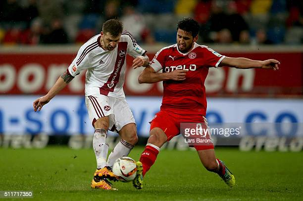 Guido Burgstaller of Nuernberg is challenged by Karim Haggui of Duesseldorf during the Second Bundesliga match between Fortuna Duesseldorf and 1 FC...