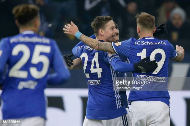 Guido Burgstaller of Schalke 04 celebrates 10 with Bastian Oczipka of Schalke 04 during the German Bundesliga match between Schalke 04 v 1 FC Koln at...
