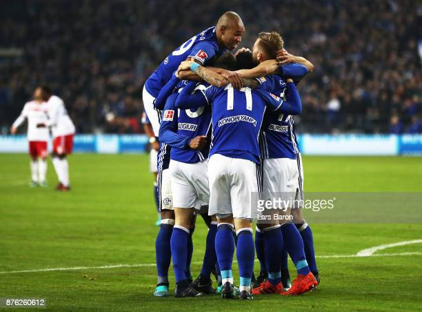 Guido Burgstaller of Schalke 04 is congratulated after scoring a goal during the Bundesliga match between FC Schalke 04 and Hamburger SV at...