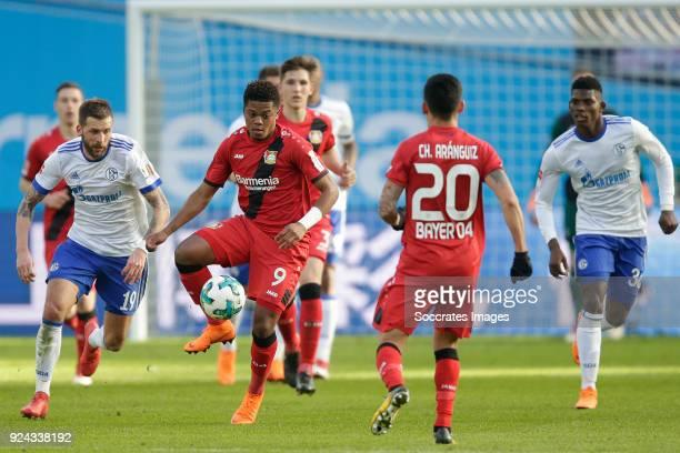 Guido Burgstaller of Schalke 04 Leon Bailey of Bayer Leverkusen Breel Embolo of Schalke 04 during the German Bundesliga match between Bayer...