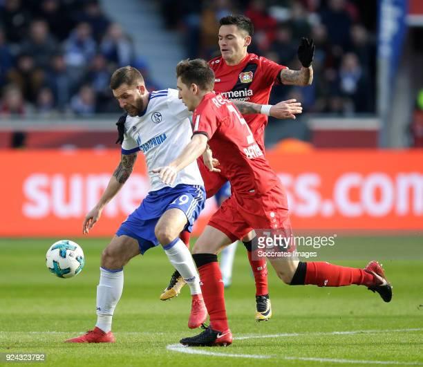 Guido Burgstaller of Schalke 04 Panagiotis Retsos of Bayer Leverkusen Charles Aranguiz of Bayer Leverkusen during the German Bundesliga match between...