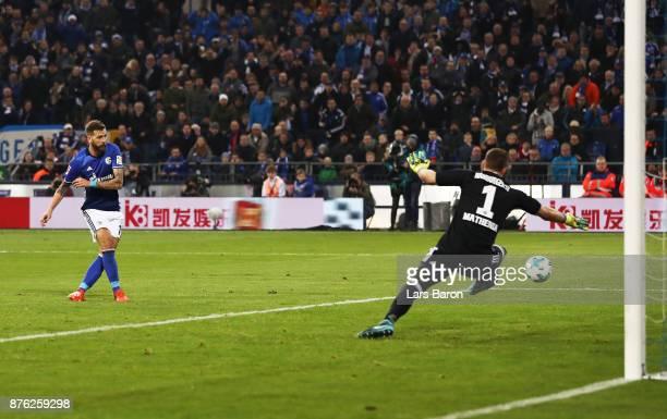 Guido Burgstaller of Schalke 04 scores a goal during the Bundesliga match between FC Schalke 04 and Hamburger SV at Veltins-Arena on November 19,...