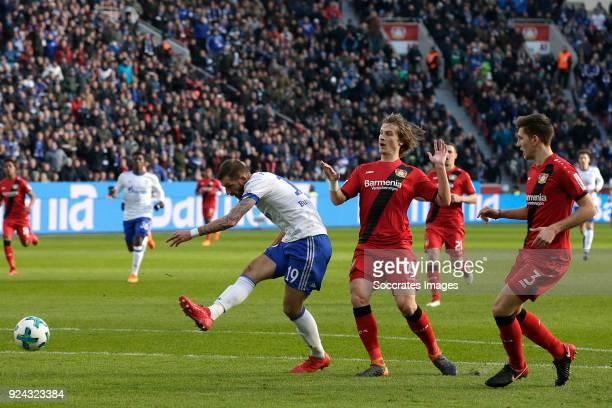 Guido Burgstaller of Schalke 04 Tin Jedvaj of Bayer Leverkusen Panagiotis Retsos of Bayer Leverkusen during the German Bundesliga match between Bayer...