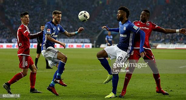 Guido Burgstaller of Schalke and Eric Maxim Choupo Moting of Schalke are seen during the Bundesliga match between FC Schalke 04 and FC Ingolstadt 04...