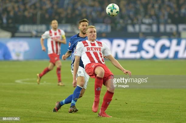 Guido Burgstaller of Schalke and Frederik Soerensen of Koeln battle for the ball during the Bundesliga match between FC Schalke 04 and 1 FC Koeln...
