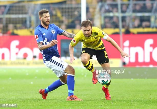 Guido Burgstaller of Schalke and Marcel Schmelzer of Dortmund battle for the ball during the Bundesliga match between Borussia Dortmund and FC...