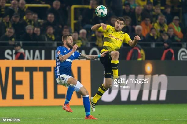 Guido Burgstaller of Schalke and Sokratis of Dortmund battle for the ball during the Bundesliga match between Borussia Dortmund and FC Schalke 04 at...