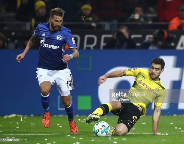 Guido Burgstaller of Schalke and Sokratis Papastathopoulos of Dortmund during the Bundesliga match between Borussia Dortmund and FC Schalke 04 at...
