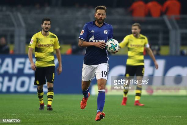 Guido Burgstaller of Schalke carries the ball after he scored a goal to make it 14 during the Bundesliga match between Borussia Dortmund and FC...