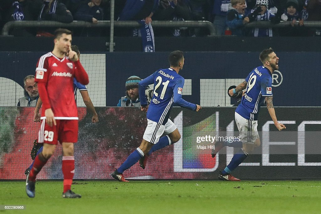 Guido Burgstaller (R) of Schalke celebrates after scoring a goal to make it 1-0 during the Bundesliga match between FC Schalke 04 and FC Ingolstadt 04 at Veltins-Arena on January 21, 2017 in Gelsenkirchen, Germany.