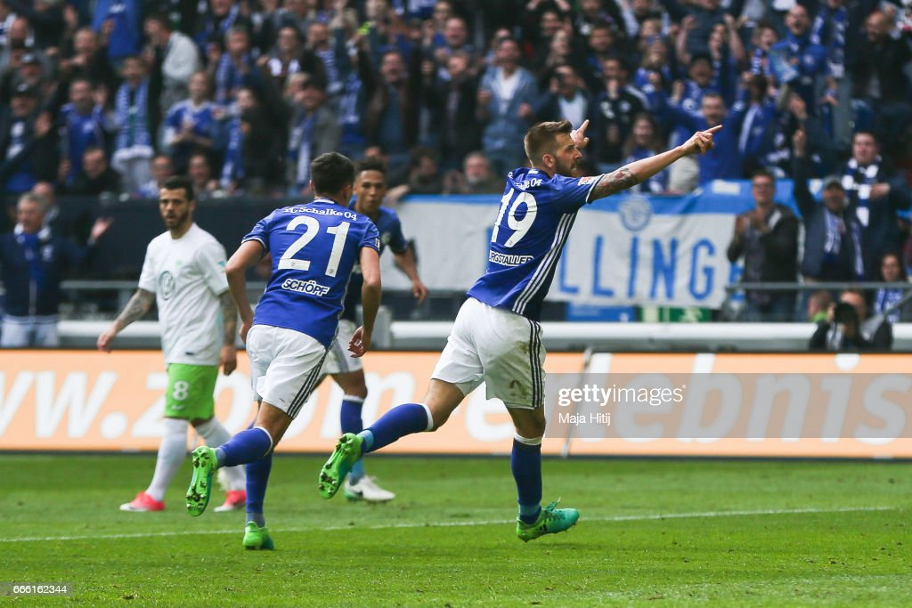 Guido Burgstaller of Schalke (R) celebrates after scoring a goal to make it 4-0 during the Bundesliga match between FC Schalke 04 and VfL Wolfsburg at Veltins-Arena on April 8, 2017 in Gelsenkirchen, Germany.