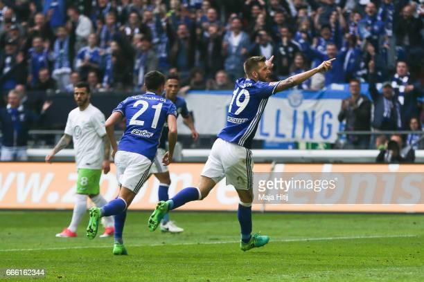 Guido Burgstaller of Schalke celebrates after scoring a goal to make it 4-0 during the Bundesliga match between FC Schalke 04 and VfL Wolfsburg at...