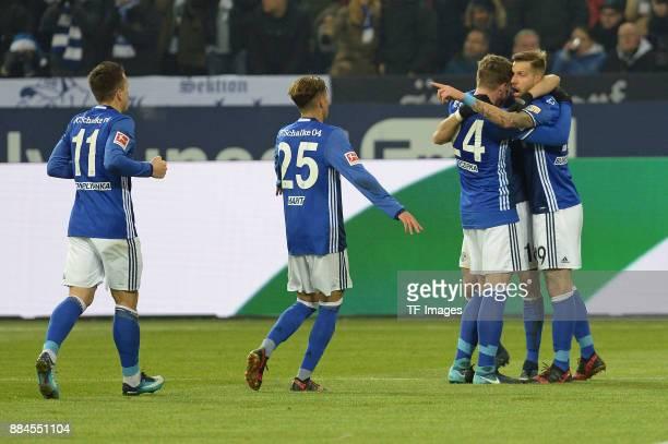 Guido Burgstaller of Schalke celebrates after scoring his team`s first goal with team mates during the Bundesliga match between FC Schalke 04 and 1...