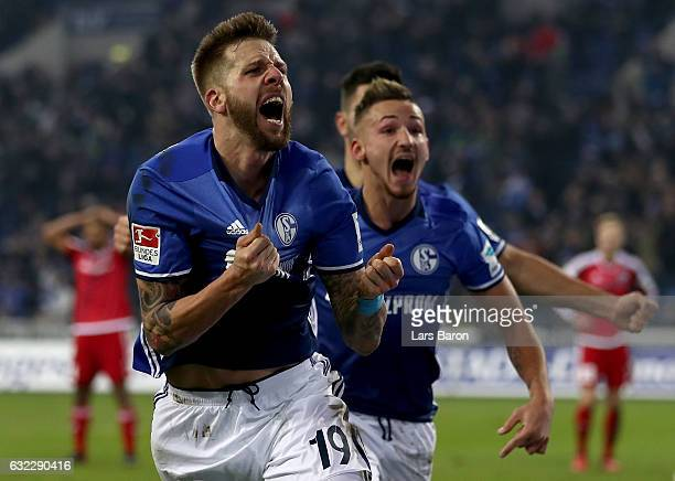 Guido Burgstaller of Schalke celebrates after scoring his teams winning goal during the Bundesliga match between FC Schalke 04 and FC Ingolstadt 04...