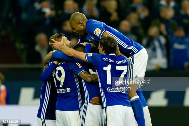 Guido Burgstaller of Schalke celebrates after scoring his team`s second goal with team mates during the Bundesliga match between FC Schalke 04 and...
