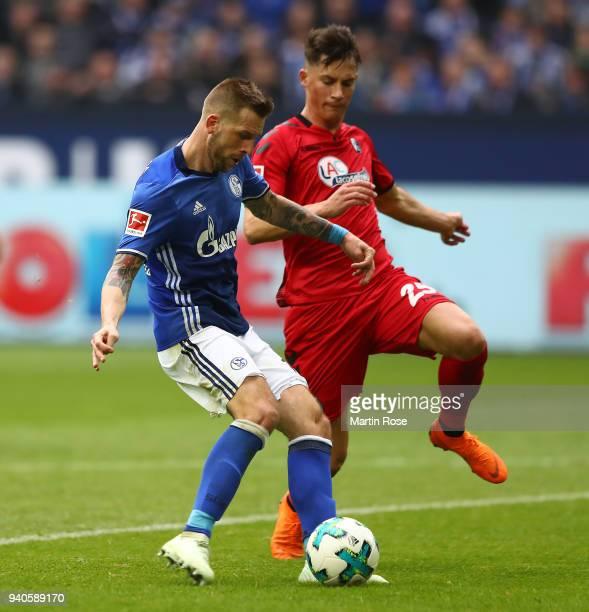 Guido Burgstaller of Schalke celebrates scores a goal to make it 20 past Robin Koch of Freiburg during the Bundesliga match between FC Schalke 04 and...