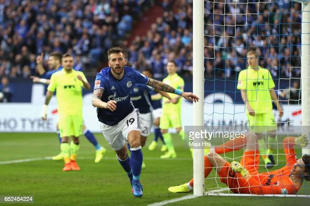 Guido Burgstaller of Schalke celebrates scoring the opening goal during the Bundesliga match between FC Schalke 04 and FC Augsburg at VeltinsArena on...