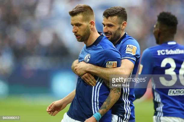 Guido Burgstaller of Schalke celebrates with Daniel Caligiuri of Schalke after he scored a goal to make it 20 during the Bundesliga match between FC...