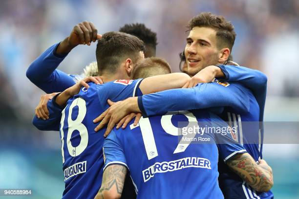Guido Burgstaller of Schalke celebrates with his team after he scored a goal to make it 20 during the Bundesliga match between FC Schalke 04 and...