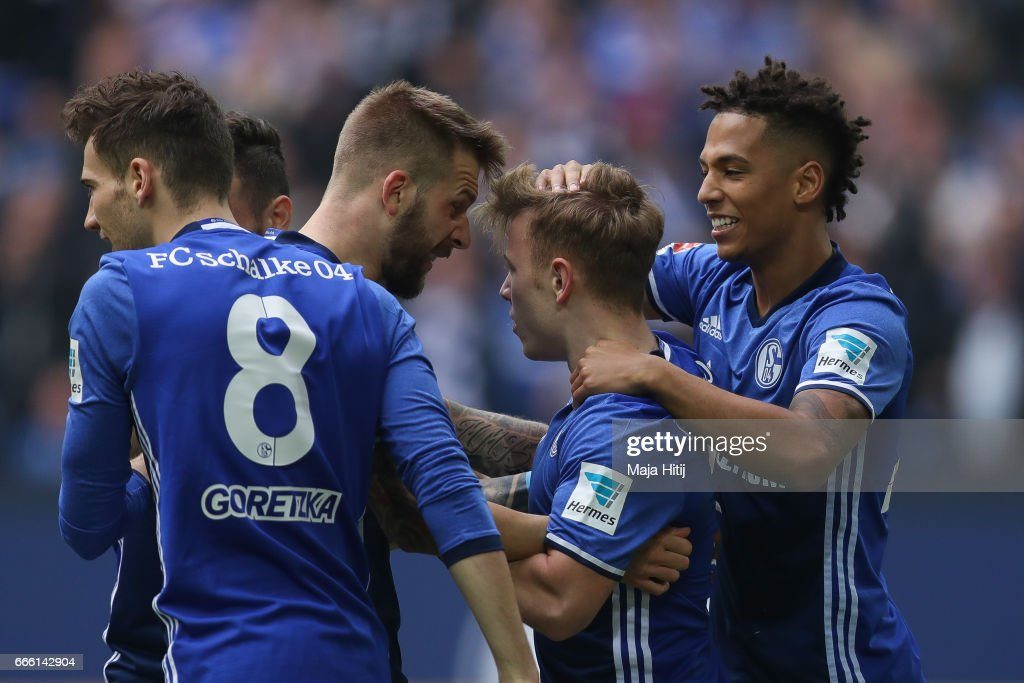 Guido Burgstaller of Schalke (2L) celebrates with his team-mates after scoring a goal to make it 1-0 during the Bundesliga match between FC Schalke 04 and VfL Wolfsburg at Veltins-Arena on April 8, 2017 in Gelsenkirchen, Germany.