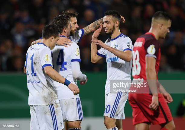 Guido Burgstaller of Schalke celebrates with his teammates after scoring his team's second goal during the DFB Cup match between SV Wehen Wiesbaden...
