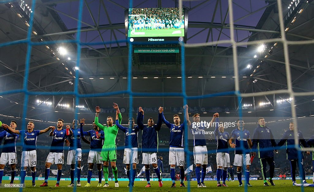 Guido Burgstaller of Schalke celebrates with team mates after winning the Bundesliga match between FC Schalke 04 and FC Ingolstadt 04 at Veltins-Arena on January 21, 2017 in Gelsenkirchen, Germany.