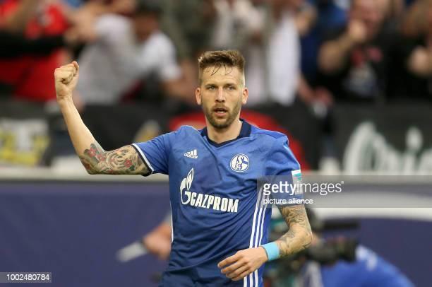 Guido Burgstaller of Schalke cheers over his 10 score during the German Bundesliga soccer match between FC Schalke 04 and Hamburger SV at the Veltins...