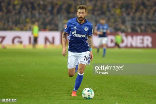 Guido Burgstaller of Schalke controls the ball during the Bundesliga match between Borussia Dortmund and FC Schalke 04 at Signal Iduna Park on...
