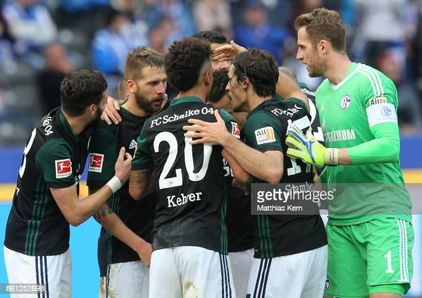 Guido Burgstaller of Schalke jubilates with team mates after scoring the second goal during the Bundesliga match between Hertha BSC and FC Schalke 04...