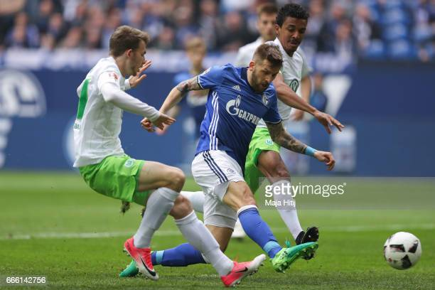 Guido Burgstaller of Schalke scores a goal to make it 1-0 during the Bundesliga match between FC Schalke 04 and VfL Wolfsburg at Veltins-Arena on...