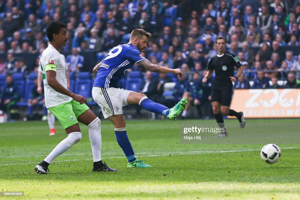 Guido Burgstaller of Schalke (2L) scores a goal to make it 4-0 during the Bundesliga match between FC Schalke 04 and VfL Wolfsburg at Veltins-Arena on April 8, 2017 in Gelsenkirchen, Germany.
