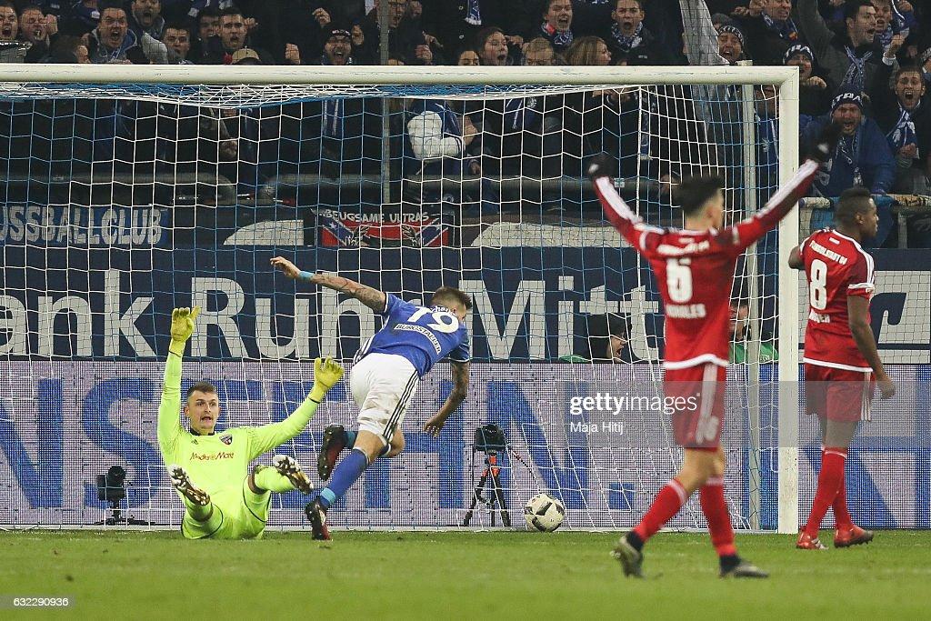 Guido Burgstaller (C) of Schalke scores his team's first goal to make it 1-0 during the Bundesliga match between FC Schalke 04 and FC Ingolstadt 04 at Veltins-Arena on January 21, 2017 in Gelsenkirchen, Germany.