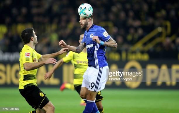 Guido Burgstaller of Schalke scores the first goal for Schalke against Sokratis of Dortmund during the Bundesliga match between Borussia Dortmund and...