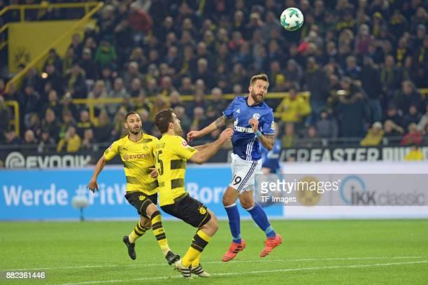 Guido Burgstaller of Schalke scores the team`s first goal during the Bundesliga match between Borussia Dortmund and FC Schalke 04 at Signal Iduna...