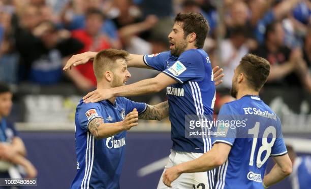 Guido Burgstaller of Schalke who scored and his teammates Jorge Moreno and Daniel Caligiuri cheer during the German Bundesliga soccer match between...