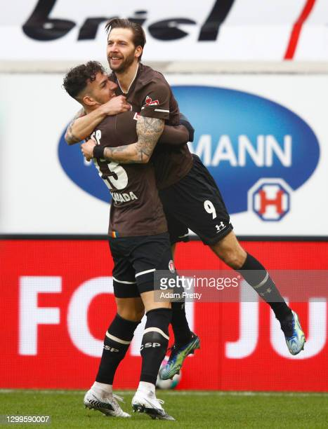 Guido Burgstaller of St. Pauli celebrates his team's first goal with teammate Leart Pacarada during the Second Bundesliga match between 1. FC...