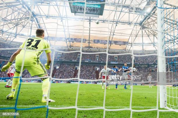 Guido Burgstaller scores his teams first goal during the Bundesliga match between FC Schalke 04 and Hamburger SV at Veltins-Arena on May 13, 2017 in...