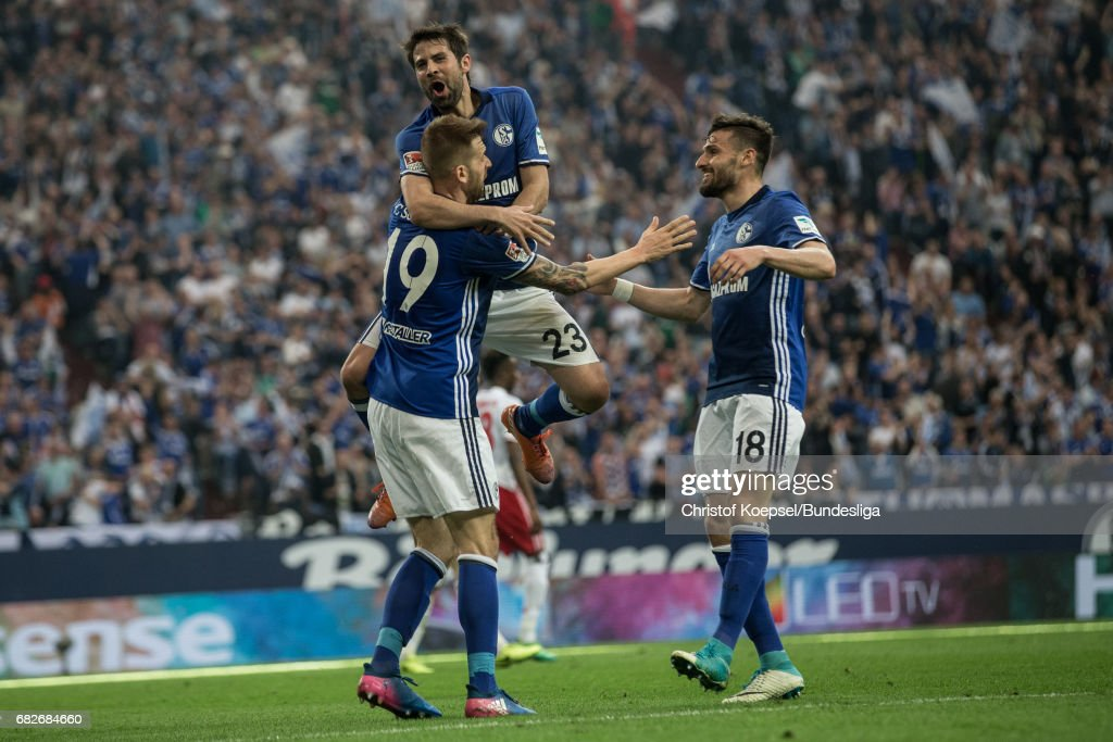 Guido Burgstallerg, Coke and Daniel Caligiuri of Schalke celebrate the first goal during the Bundesliga match between FC Schalke 04 and Hamburger SV at Veltins-Arena on May 13, 2017 in Gelsenkirchen, Germany. The match between Schalke and Hamburg ended 1-1.