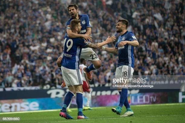 Guido Burgstallerg, Coke and Daniel Caligiuri of Schalke celebrate the first goal during the Bundesliga match between FC Schalke 04 and Hamburger SV...