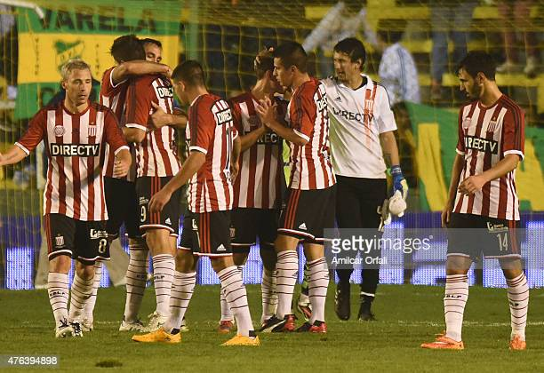 Guido Carrillo and his teammates of Estudiantes celebrate after winning a match between Defensa y Justicia and Estudiantes as part of 15th round of...