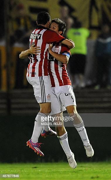Guido Carrillo and Joaquin Correa of Argentina's Estudiantes celebrate a goal against Uruguay Penarol during their Sudamericana Cup football match at...
