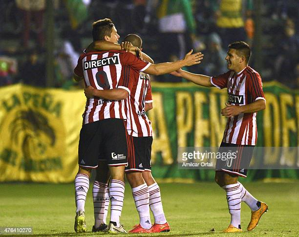 Guido Carrillo of Estudiantes celebrates with his teammates after scoring the first goal of his team during a match between Defensa y Justicia and...