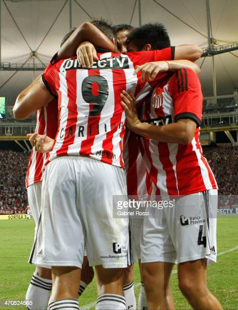 Guido Carrillo of Estudiantes celebrates with team mates after scoring the second goal of his team in a penalty kick during a match between...