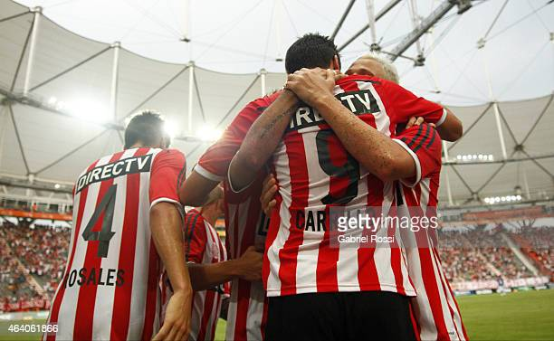 Guido Carrillo of Estudiantes celebrates with teammates after scoring a penalty kick during a match between Estudiantes and Godoy Cruz as part of...