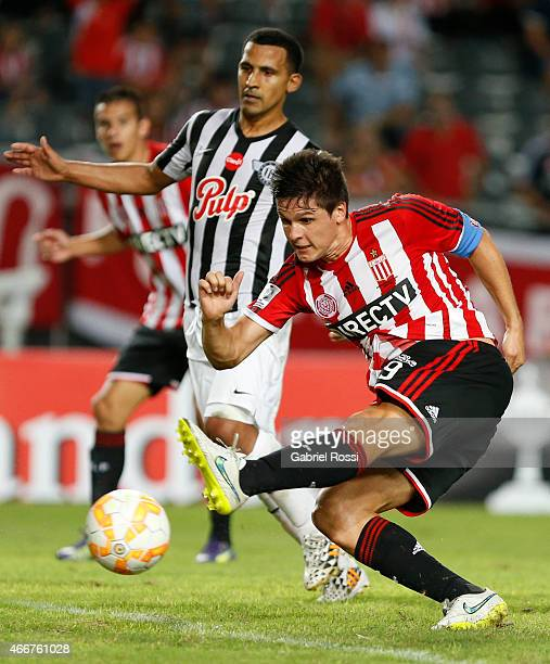 Guido Carrillo of Estudiantes kicks the ball to score the first goal of his team during a match between Estudiantes and Libertad as part of Copa...