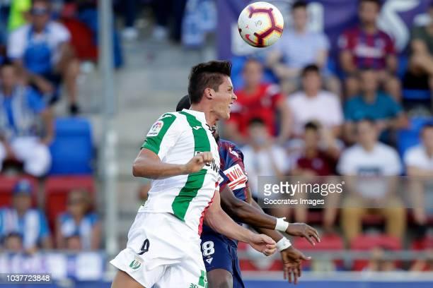 Guido Carrillo of Leganes Pape Diop of SD Eibar during the La Liga Santander match between Eibar v Leganes at the Estadio Municipal de Ipurua on...