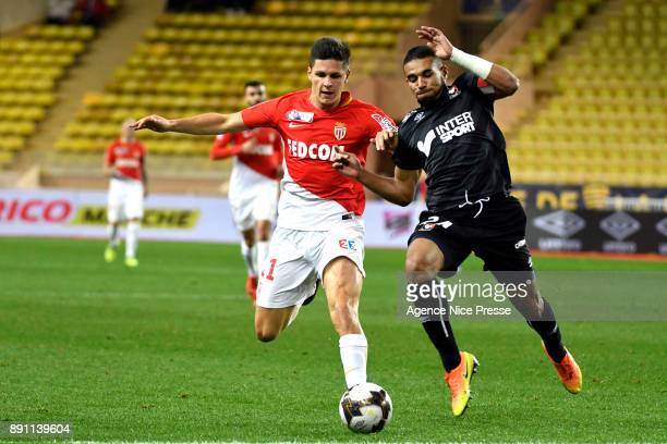 Guido Carrillo of Monaco and Alexander Djiku of Caen during the french League Cup match Round of 16 between Monaco and Caen on December 12 2017 in...